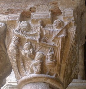 Capitell de sant Miquel i els dimoni pesant les ànimes.